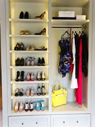 Amazing walk-in closet design with gray built-in cabinets and gray shoe  shelves.