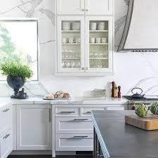glass kitchen cabinet doors. Perfect Glass White Range Hood On Calcutta Marble Backsplash In Glass Kitchen Cabinet Doors