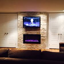 42 tv and napoleon electric fireplace with beachwood natural slate wall tile and side by