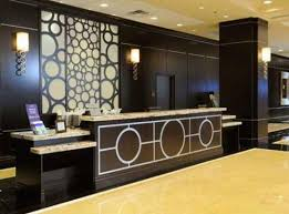 love this idea Modern Lobby Hotel Interior Design Do Try This at Home:  Mixed Prints. mixing patterns home decor chandelier. Hotel Reception Desk  ...