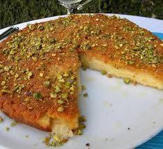 knafeh a flat platter usually made with semolina dough and a filling of melted gooey cheese or clotted cream image 1