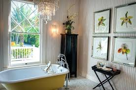 beach cottage bathroom cottage bathroom with claw foot bathtub under crystal chandelier also small table and