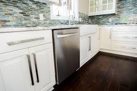 built in stainless steel dishwasher white cabinets tile backsplash