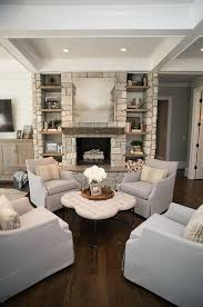 four chairs together creates an inviting sitting area by the fireplace living room chairs are azriel swivel glider from sam moore furniture