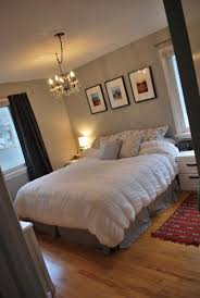 Hanging three picture frames above the bed=good for a bed with no headboard
