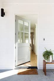 pale gray front door with glass panels