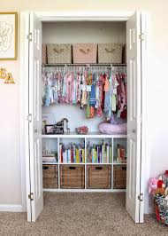 Dwelling & Telling: Sadie Ann's Pink and Gold Nursery Organized nursery  closet