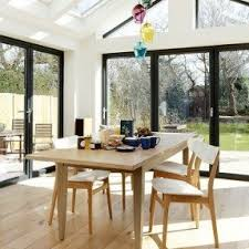light kitchen table. conservatory dining area with oak flooring decorating light kitchen table
