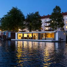 Floating Home By +31 Architects Is Moored On An Amsterdam River ...