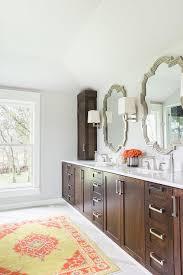 alyssa rosenheck walnut stained bathroom vanity cabinets with yellow and orange rug