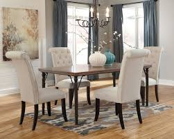this beautiful dining table four chairs set boasts of rustic brown finished top supported by the