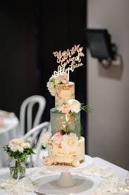 10 Creative Wedding Cake Toppers Youll Love Easy Weddings Articles