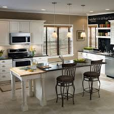 kitchen kitchen with mini pendants and recessed lighting
