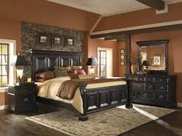 bedroom rustic country traditional bedrooms designs with black wooden headboard and stone wall paneling plus