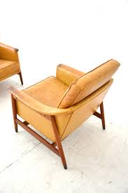 tan leather teak framed easy chair with all new webbing in the seat