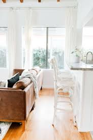 eco chic furniture. Cozy Living Room And Minimalist Kitchen With Neutral, Eco-chic Decor, A Leather Eco Chic Furniture
