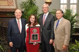 awards newsroom julia chew president david boren chairman of the regents jon stuart and dr