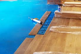 laying hardwood flooring by gluing directly to concrete
