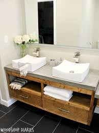 Modern Bathroom with DIY Floating vanity and concrete counter tops, vessel  sinks, and silver