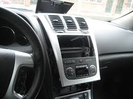 gmc acadia forum navigation lockout bypass for about 3 bucks step 5 remove the lower center console trim which is held on by clips start at the back and work your way forward as you are going forward tilt the back