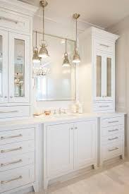 white bathroom cabinets. all white bathroom features an extra wide single vanity topped with marble under a polished cabinets