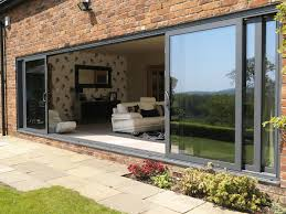 large sliding patio doors: delamere cheshire installtion of allstyle large sliding doors double glazed with celcius clear self cleaning units u value  marine finish pol