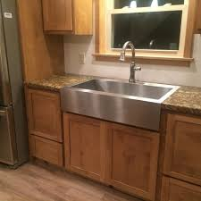 farmhouse sink with laminate countertops