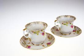 Decorative Cups And Saucers Two Porcelain Decorative Cups With Saucers On Isolated White 16