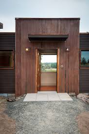corrugated metal on interior walls exterior eclectic with hardiplank siding gravel pathway metal exterior