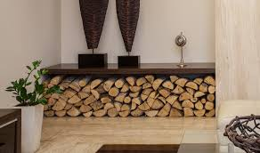 storing firewood indoors can be achieved in any living space whether it be outdoors