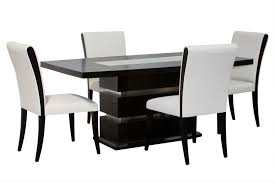 amazing black and white dining table set design with white color leather chairs feat awesome wooden table leg