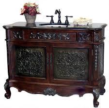antique style wooden vanity set with metallic detail
