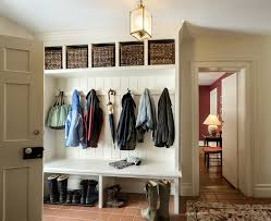 Saving Small And Narrow Entryway Spaces With White Wood Wall Built In  Mudroom Cubby With Tray Shoe Storage Under Bench Seat And Hooks Under  Rattan Basket ...