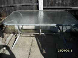 patio table with frosted glass top could do with repaint