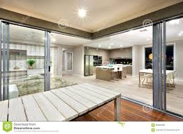 view modern house lights. Beautiful House Download Inside View Of A Modern House Lights Turned On With Wooden Table  Stock Photo