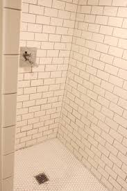 the grit and polish tile shower surround and floor