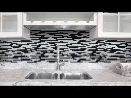 black gray and white backsplash tile