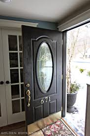 front door makeover with black paint and br hardware goldenboysandme