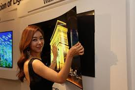 lg wallpaper tv. a model shows off the lg wallpaper oled at an event in 2015. lg tv 7