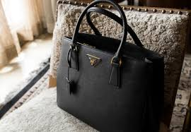 a classic black prada galleria bag is a handbag wardrobe staple easy to use daily and can work on the weekends too but when you need to throw your ipad