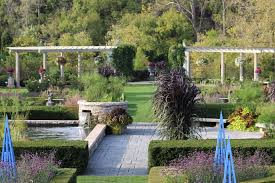 peripheral plantings surround and define this very special space designed as a french formal garden