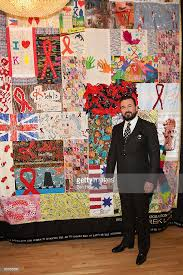 Kiehl's Unveils World AIDS Day Quilt Photos and Images | Getty Images & President of Kiehl's USA Chris Salgardo attends the unveiling of the world  AIDS day quilt at Adamdwight.com
