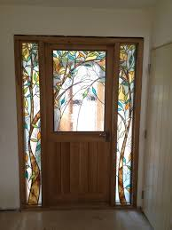 oak front door with hand made stain glass finish