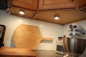 under cabinet lighting for kitchen. Under The Kitchen Cabinet Lighting. Simple Puck Lights Lighting Example. Decoration For I