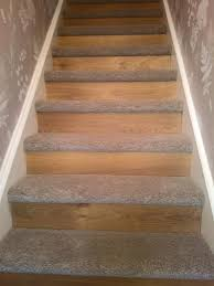 starting a new trend oak laminate flooring to the riser and new thick saxony carpet onto