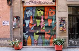 garage door artTravelettes   Street art and graffiti on Barcelonas shutter doors