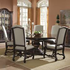 interesting dining room with brown expandable round dining table and brown dining chairs also centerpiece