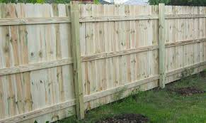 install the fence rails and pickets by ing them to the posts
