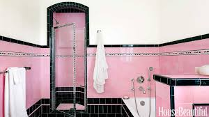 very bold and retro bathroom in pink and black tile