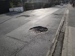 Image result for hole in the street